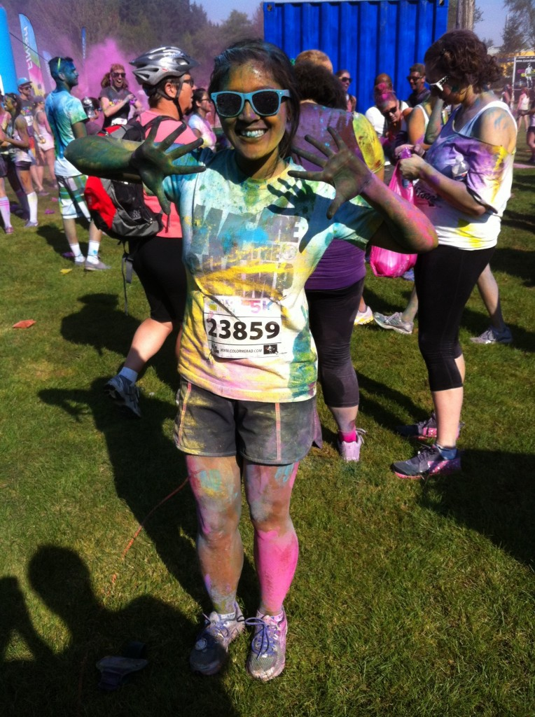 Karra Barron covered in different coloured powder after running the Color Me Rad Vancouver 5K