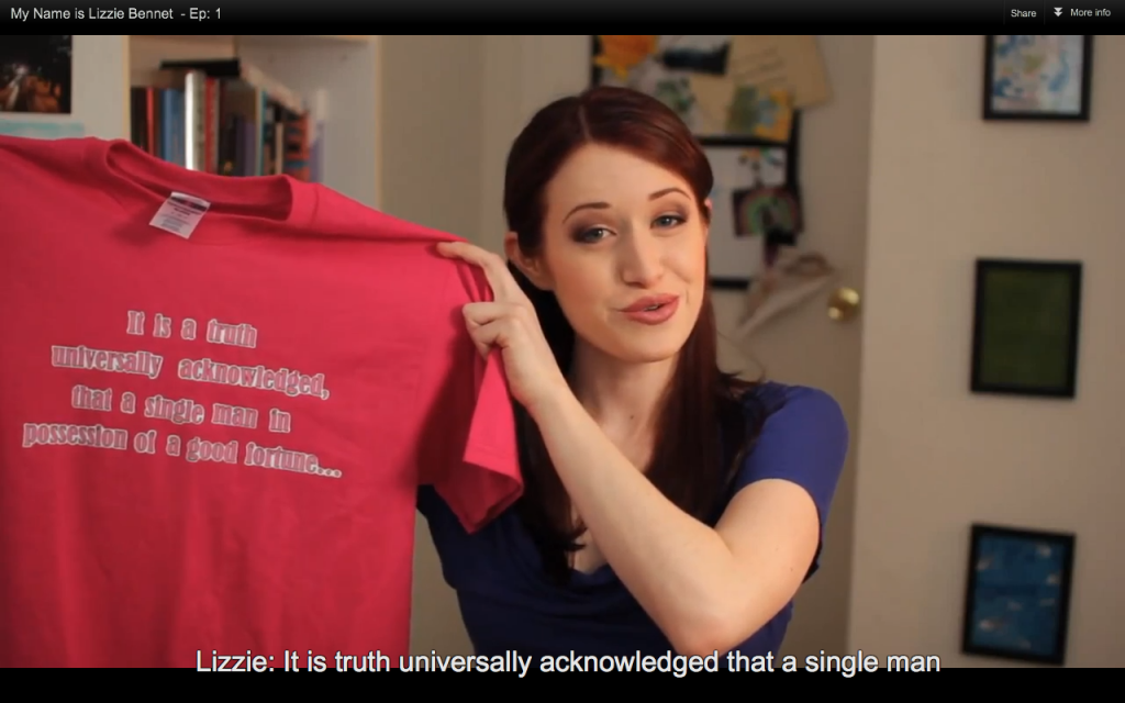 "Screen shot of a scene from the Lizzie Bennet Diaries. Lizzie is holding up a tshirt that says ""It is a truth universally acknowledged that a man..."""