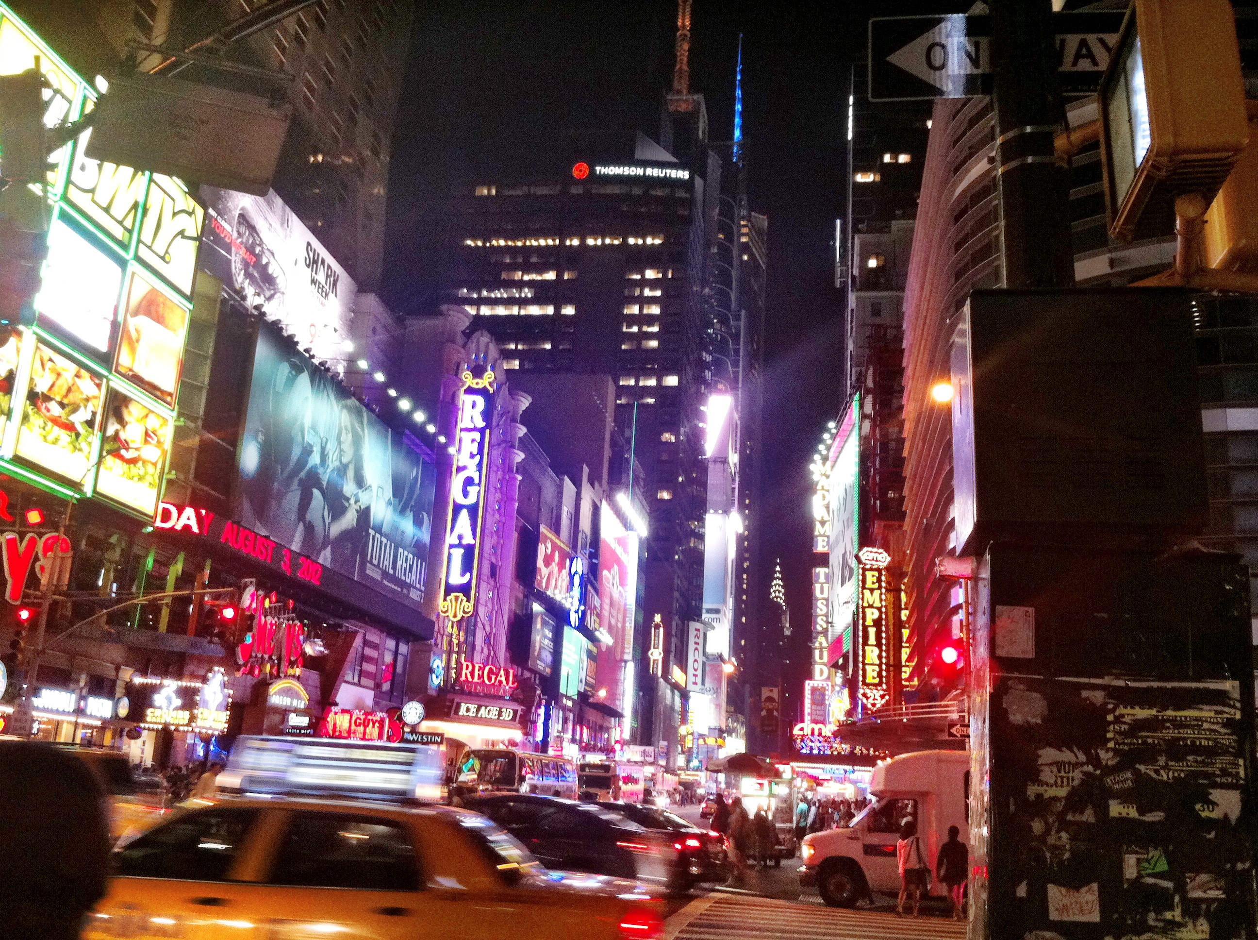 New York City travel: image of Times Square area lights and action at midnight