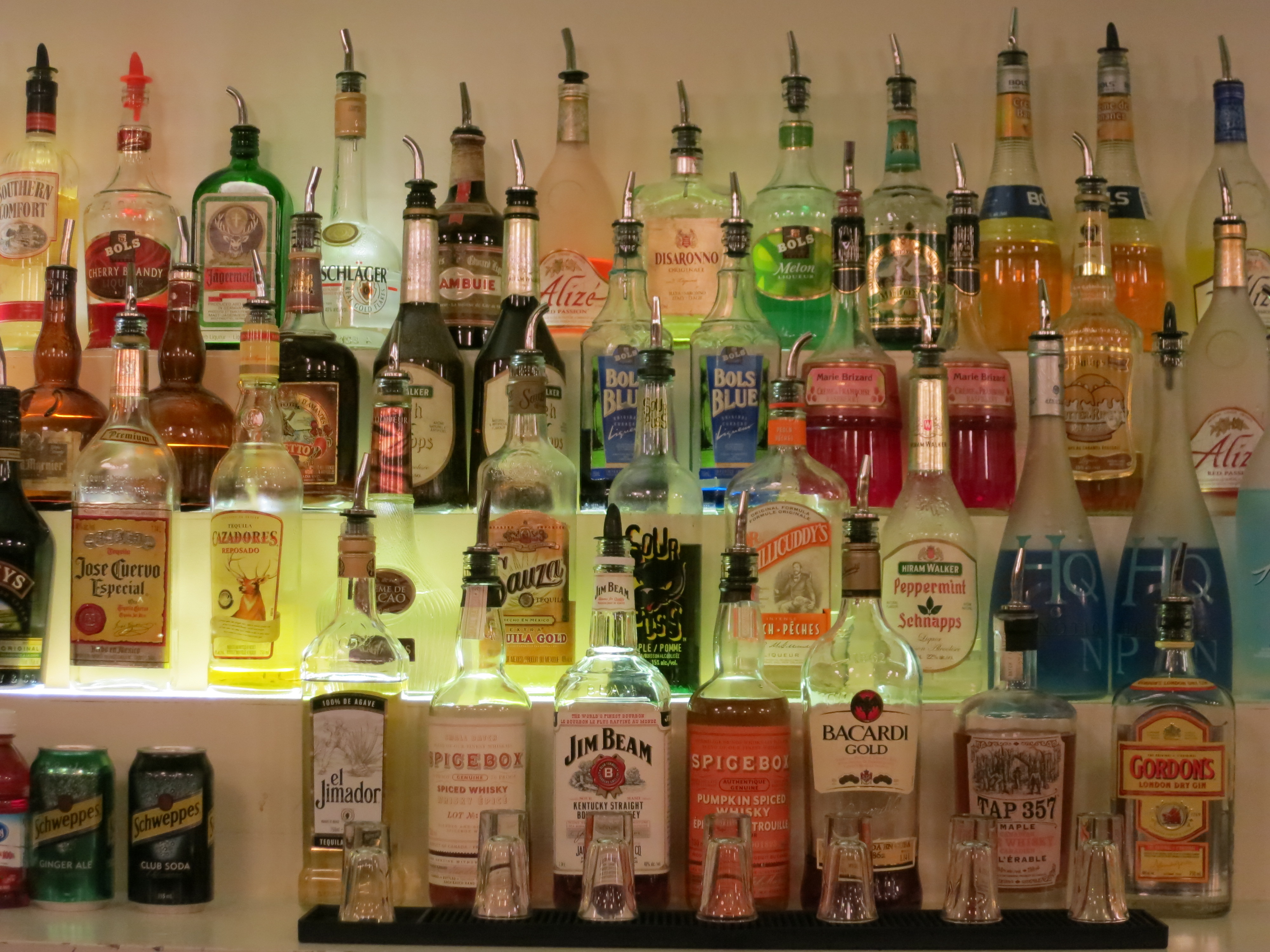 Different bottles of liquor lined up on shelves at the Metropolitan Bartending School in Vancouver, BC