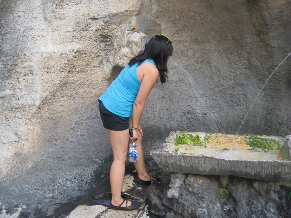 Karra Barron trying out Virgin Water at the Trevi Fountain