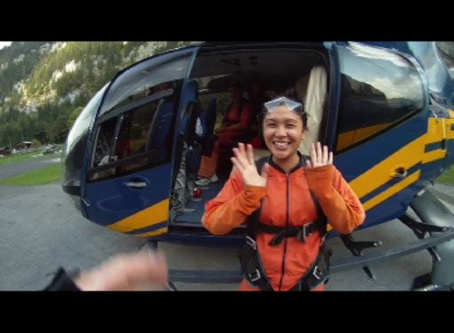 Skydiving in Switzerland, Karra Barron stands in front of the helicopter