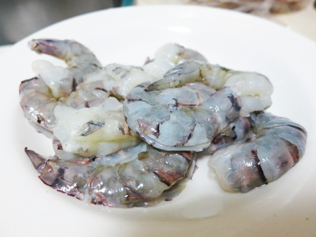 Peeled black tiger prawns